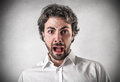 Scared young man with a scary and astonished expression Royalty Free Stock Photo