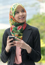 Scarf girl braces teeth use smart phone Stock Photos