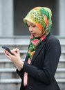 Scarf girl use smart phone Stock Photography