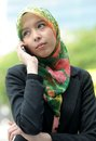 Scarf girl use smart phone Stock Image
