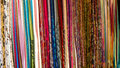 Scarf on hangers at street market. Stock Photos
