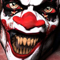 Scarier clown close up a of a with sharp pointy teeth glaring at you Stock Images