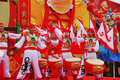 Scarlet flags and red drums of the dancers Stock Photos