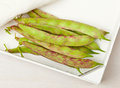 Scarlett runner beans heap of organic in wooden box Stock Photo