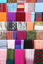 Scarves colorful stacked in a fashion shop Royalty Free Stock Photo