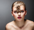 Scary Arachnid Predator on Beauty Woman Face sitting Stock Images