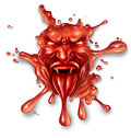 Scary blood with an evil halloween vampire character splattered and dripping on a white background as a spooky symbol of danger Royalty Free Stock Photo