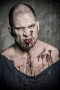 Scary and bloody zombie man a Stock Image