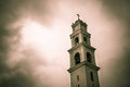 Scary church clock tower red and black overlay colors Stock Image