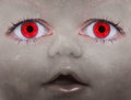 Scary doll face with human looking eyes Royalty Free Stock Photo