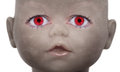 Scary doll face with human looking eyes Royalty Free Stock Images