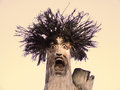 Scary face carved in a tree iznota poland Royalty Free Stock Photo