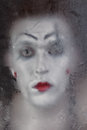 Scary face screaming mime for murky glass closeup Stock Images