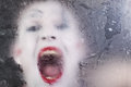 Scary face screaming mime for murky glass closeup Royalty Free Stock Photography