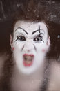 Scary face screaming mime for murky glass closeup Royalty Free Stock Image