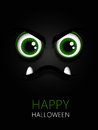 Scary green eyes with halloween wishes over dark Stock Photos