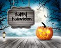 Scary Halloween background with pumpkins and wooden sign Royalty Free Stock Photo
