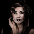 Scary halloween style closeup portrait of young woman with makeup isolated on black background carnival costume of witch party Royalty Free Stock Photos