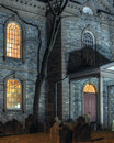 Scary house exterior facade of haunted church with graveyard at night Royalty Free Stock Photography