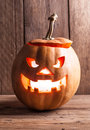 Scary jack o lantern dark on wood Royalty Free Stock Images