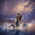 Scary loch ness monster emerging from water photo composite of Stock Photography