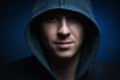 Scary man with hood in darkness Royalty Free Stock Photography