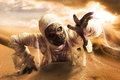 Scary mummy in a desert at sunset halloween hot with dramatic lighting Stock Photography