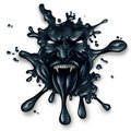 Scary oil spill splash as petroleum leaking with a monster face as a symbol for fossil fuel and crude energy fear concept on a Royalty Free Stock Image