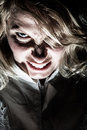 Scary psycho blonde woman frustrated and looking at the camera Royalty Free Stock Image
