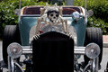 Scary souped up hotrod car with skeleton