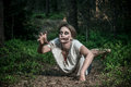 A scary undead zombie girl lying on the ground Royalty Free Stock Photography