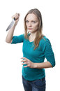 Scary woman with knife holding kitchen Stock Images