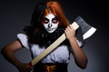 Scary woman with metal axe Royalty Free Stock Photo