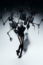 Scary woman with spider web and skeletons Royalty Free Stock Photo