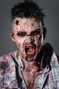 Scary zombie cosplay aggressive creepy in clothes Royalty Free Stock Images