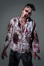 Scary zombie cosplay aggressive creepy in clothes Stock Photo