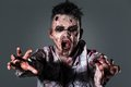 Scary zombie cosplay aggressive creepy in clothes Stock Photos
