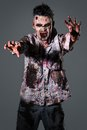 Scary zombie cosplay aggressive creepy in clothes Stock Image