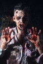 Scary zombie cosplay creepy behind the window Royalty Free Stock Photos