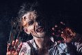 Scary zombie cosplay creepy behind the window Royalty Free Stock Image