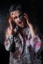 Scary zombie cosplay creepy behind the window Royalty Free Stock Photo