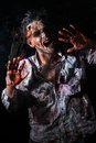 Scary zombie cosplay creepy behind the window Royalty Free Stock Photography
