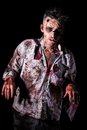 Scary zombie cosplay creepy on a black background Royalty Free Stock Images