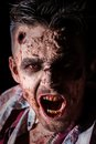 Scary zombie cosplay creepy on a black background Stock Photo