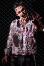 Scary zombie cosplay creepy on the fence background Stock Photo
