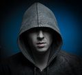 Scary zombie man with hood in darkness Stock Photography