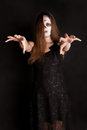 Scary zombie woman in black dress Stock Photography