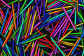 Scattered colouring pencils on a black background Stock Photography