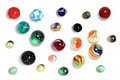 Scattered marbles on white background collection of randomly of different sizes and types isolated a with shadows Stock Images