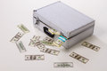 Scattered money dollars with suitcases Royalty Free Stock Images